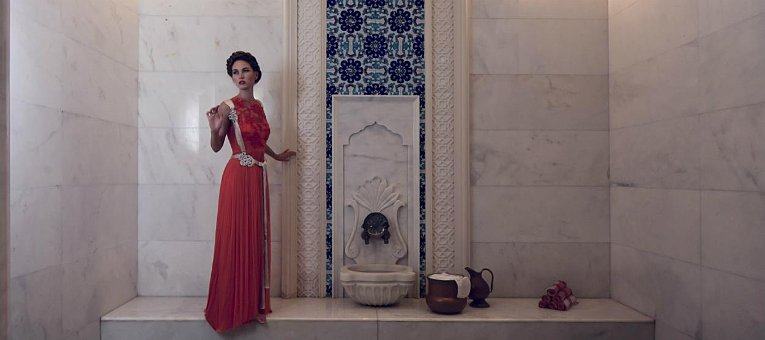 jumeirah-zabeel-saray-spa-lifestyle-red-dress-fountain-hero.765x340.jpg